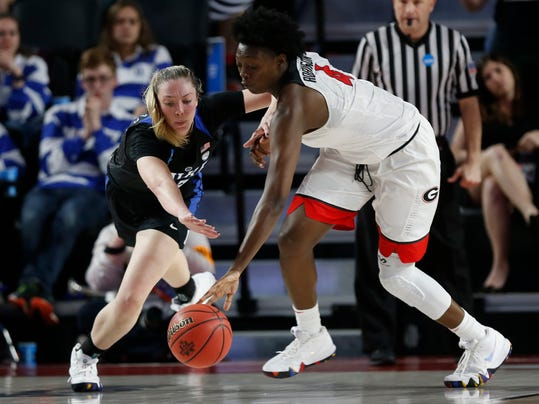 Duke forward/center Erin Mathias (35) loses position of the ball to Georgia forward Caliya Robinson (4) during the second half of a second-round game in the NCAA women's college basketball tournament in Athens, Ga., Monday, March. 19, 2018. Duke won 66-40. (AP Photo/Joshua L. Jones)