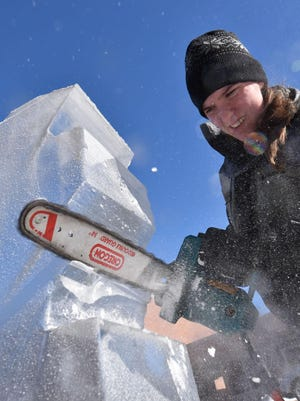 Amber Evers of Neenah carves a phoenix out of ice along North Third Avenue during last year's Fire & Ice in Sturgeon Bay.