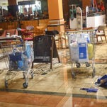 This photo taken Friday, Sept. 27, 2013 and made available Monday, Sept. 30, 2013, shows forensic investigators working on the ground floor of the Westgate Mall in Nairobi, Kenya. The four-day siege, which included the collapse of part of the mall, left 67 people dead, according to officials. (AP Photo)