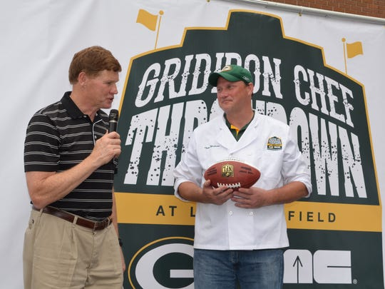 Green Bay Packers president and CEO Mark Murphy, left, congratulates Tom Wilson on winning the first Gridiron Chef Tailgate Throwdown at Lambeau Field last month.