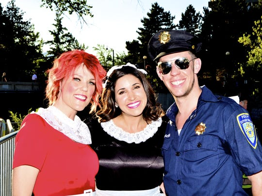 "From left: Emcees Connie Wray and Kristen Remington take a moment with ""officer"" Patrick Connolly at Pops on the River, the Reno Philharmonic's celebration of Broadway."
