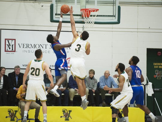 Vermont's Anthony Lamb (3) leaps to block the shot