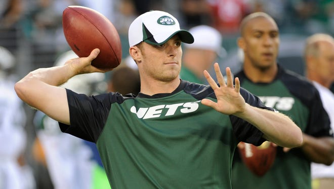 New York Jets quarterback Greg McElroy throws before a preseason NFL football game against the Philadelphia Eagles, Thursday, Aug. 29, 2013, in East Rutherford, N.J. (AP Photo/Bill Kostroun)