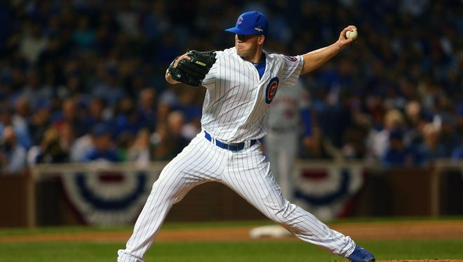 Lafayette native Clayton Richard re-signed with the Cubs on Wednesday.