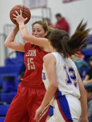 Elgin's Amy Hafer looks to pass against Highland in a girls basketball game last season.