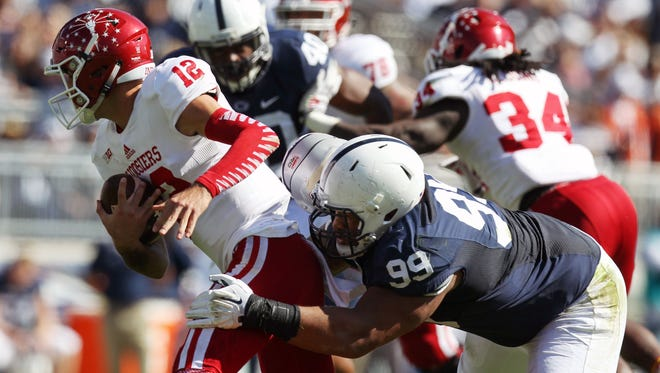 Indiana quarterback Zander Diamont (12) is  sacked by Penn State defensive tackle Austin Johnson (99) during the second quarter.