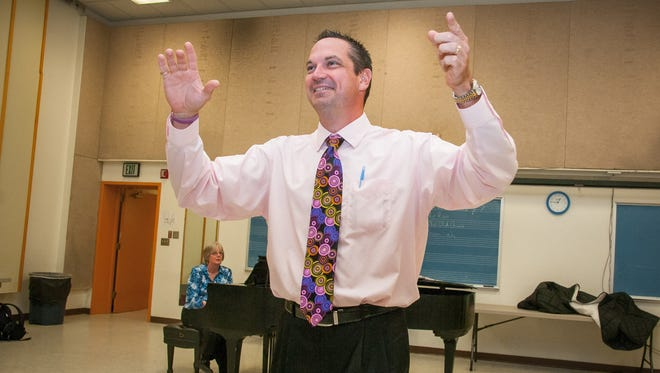 """New Mexico State University Director of Choral Studies John Flanery rehearses """"Cipriano de Rore's Laudem dicite Deo nostro"""" with NMSU's University Singers' Choir at the Atkinson Music Center."""
