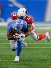 Cardinals linebacker Haason Reddick tackles Lions running