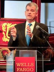 Wells fargo president Tim Sloan speaks at the opening
