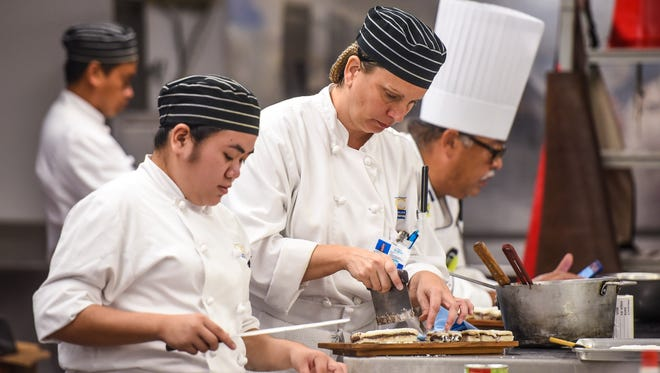 Culinary students Gerelyn Ebidag, front, and Bethany Lopez at Guam Community College are shown in this April 5, 2018, file photo.
