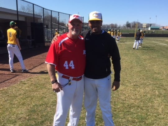 Rancocas Valley head coach Dave Hower poses for a picture with Clearview coach Rolando Gautier on Opening Day. Hower coached Gautier at Pennsauken.