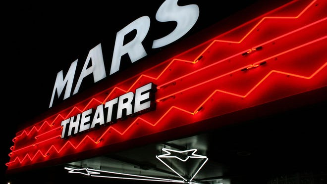 I like this photo because the neon is a throwback that so well represents the historic Mars Theatre, which opened in Springfield in April. (G.G. Rigsby/Effingham Now).