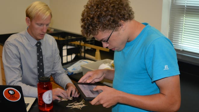 Bazil Harmon uses an iPad in Jeff Kilner's physics class at Sussex Central High School.