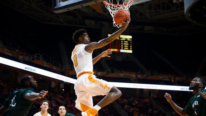 Tennessee's Jordan Bone tries to score after getting past Slippery Rock's Khyree Wooten at Thompson-Boling Arena on Thursday, November 2, 2016.