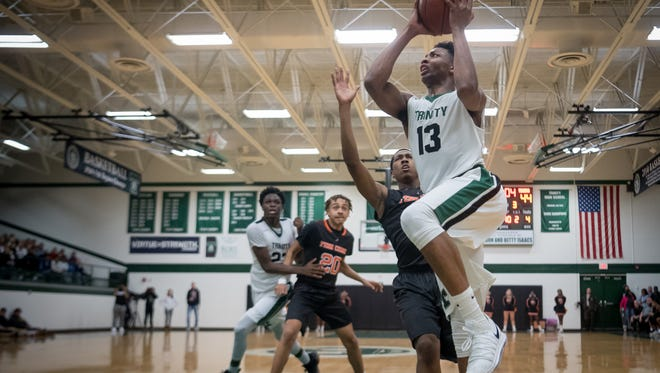 Trinity's David Johnson (13) shoots the layup during the game against Fern Creek at Trinity High School in Louisville, Kentucky, Saturday, December 9, 2017
