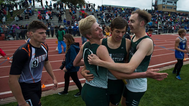 Heritage Christian's boys relay team celebrates after winning the Class 1A title Saturday to cap the school's third straight Class 1A team title at the Colorado state track and field championships at Jeffco Stadium in Lakewood.