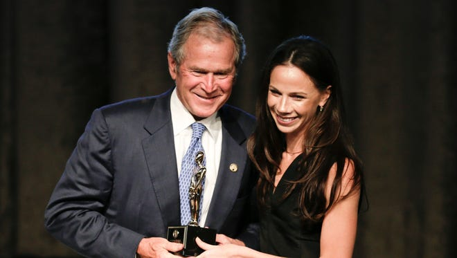 Former President George W. Bush, left, poses with his daughter, Barbara, after receiving an award at the 74th Annual Father of the Year Awards benefit luncheon Thursday, June 18, 2015, in New York, N.J. (AP Photo/Frank Franklin II)
