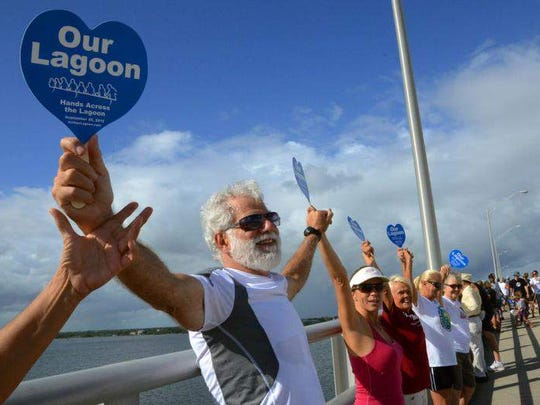Terry Casto, Janice Spragins and hundreds of others stand on the Melbourne Causeway bridge during Hands Across the Lagoon, an event in September to highlight the plight of the Indian River Lagoon.