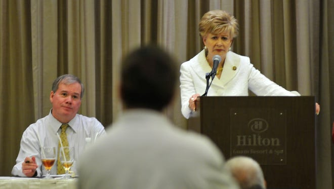 Guam Delegate Madeleine Bordallo, right, and her Chief of Staff, John Whitt, listens to a town hall meeting held at the Hilton Guam Resort & Spa in 2009.