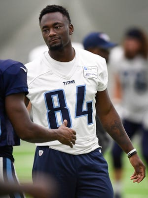 Titans wide receiver Corey Davis (84) chats with a teammate during training camp practice Monday, Aug. 14, 2017.