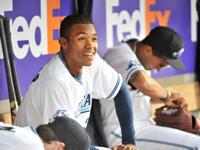 Whitecaps outfielder Jose Azocar in the dugout in the