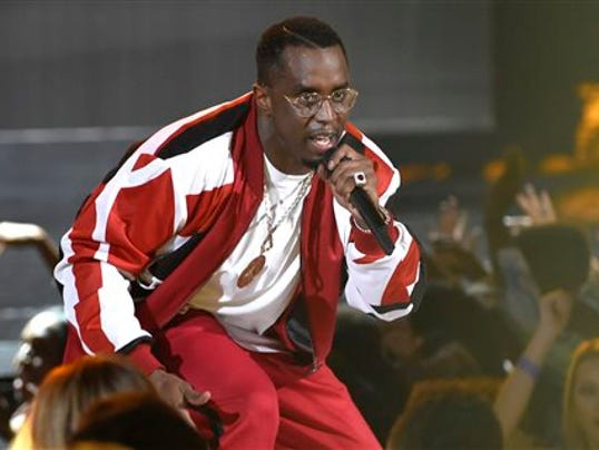 """FILE - In this Sunday, June 28, 2015 file photo, Sean """"Diddy"""" Combs performs at the BET Awards at the Microsoft Theater in Los Angeles. A spokesman for the Los Angeles City Attorney's Office said on Wednesday, Sept. 9, 2015, that an Oct. 15, 2015 hearing, known as an informal conference, has been set to determine whether Combs will face any penalties, ranging from restitution payments and counseling to a possible misdemeanor charge, over a June incident in which police say he wielded a kettlebell at the University of California, Los Angeles.  (Photo by Chris Pizzello/Invision/AP, File)"""
