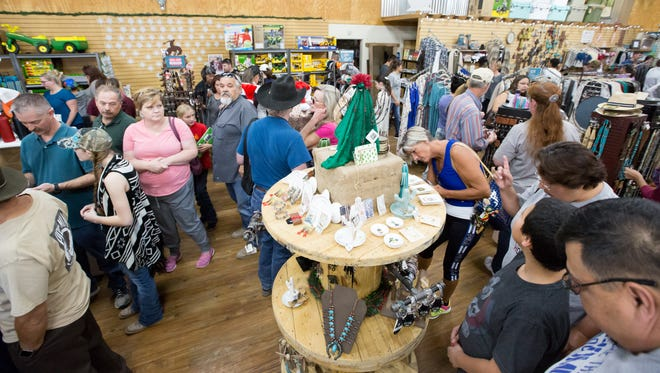 Many gather to support small businnesses and find good deal on Saturday, November 25, 2017, during Small Business Saturday at Horse & Hound Feed N Supply.