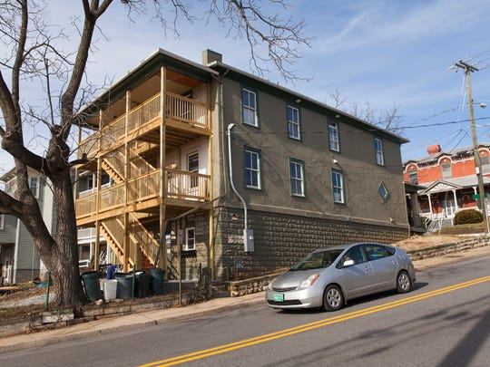 A car passes by the historic home at 240 Kalorama Street that is being renovated by the non-profit Valley Area Community Support on Friday, Dec. 26, 2014.