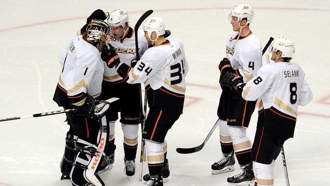 The Anaheim Ducks celebrate their win against the Chicago Blackhawks at  the United Center.