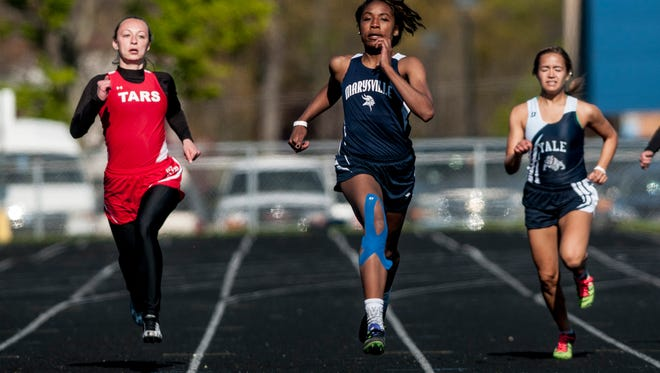 Marysville's Mya Rhodes competes in the 200 meter run during a track meet on  May 12, 2017 at Marysville High School.