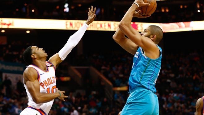 Mar 10, 2018; Charlotte, NC, USA; Charlotte Hornets guard Nicolas Batum (5) shoots the ball against Phoenix Suns guard Shaquille Harrison (10) in the first half at Spectrum Center. Mandatory Credit: Jeremy Brevard-USA TODAY Sports