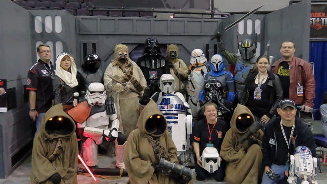 Members of the 501st Legion get together for a group shot Sunday afternoon as the final day of Pensacon 2015 Sunday, as the con started to come to a close at the Pensacola Bay Center.