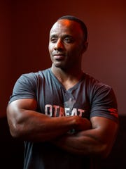 Olaudah Parker, a trainer at Orangetheory Fitness, poses for a portrait on Thursday, October 20, 2016 in North Naples. Parker is a veteran of the United States Army.