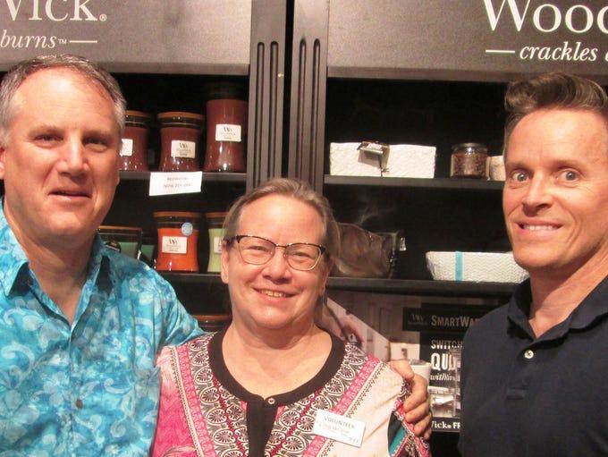 Scott and Karen Guisbert  and Rick Neale attend the