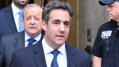 Michael Cohen leaves a federal courthouse in New York