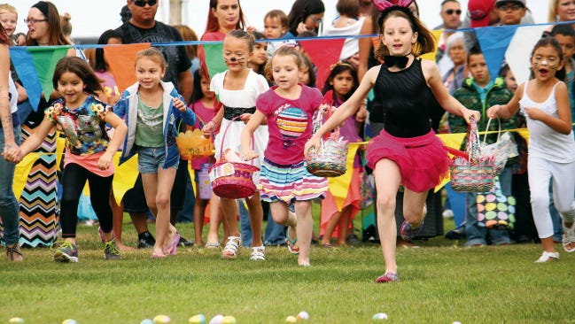 Children rush to gather Easter eggs in Alameda Park during last year's event.
