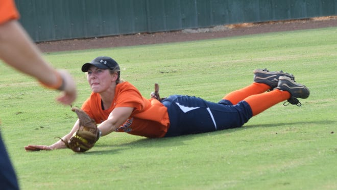 Louisiana College freshman Shelby Bergeron dives for a fly ball at practice Thursday. The Lady Wildcats will go to Sulphur to play in the McNeese State University Cowgirl Fall Classic this weekend.