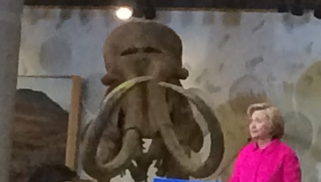 Wooly mammoth skeleton flanks stage at Hillary Clinton rally at Iowa State Historical Museum.