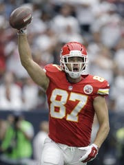 Chiefs tight end Travis Kelce (87) celebrates his touchdown catch against the Houston Texans.