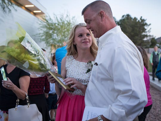 The time after the death of Brandi Schamadan, wife and mother, has been marked by firsts, including 13-year-old Lexi's eighth-grade graduation from Paradise Valley Christian Preparatory. After the ceremony, in the crowd of parents and students, Mike Schamadan hugs his daughter.