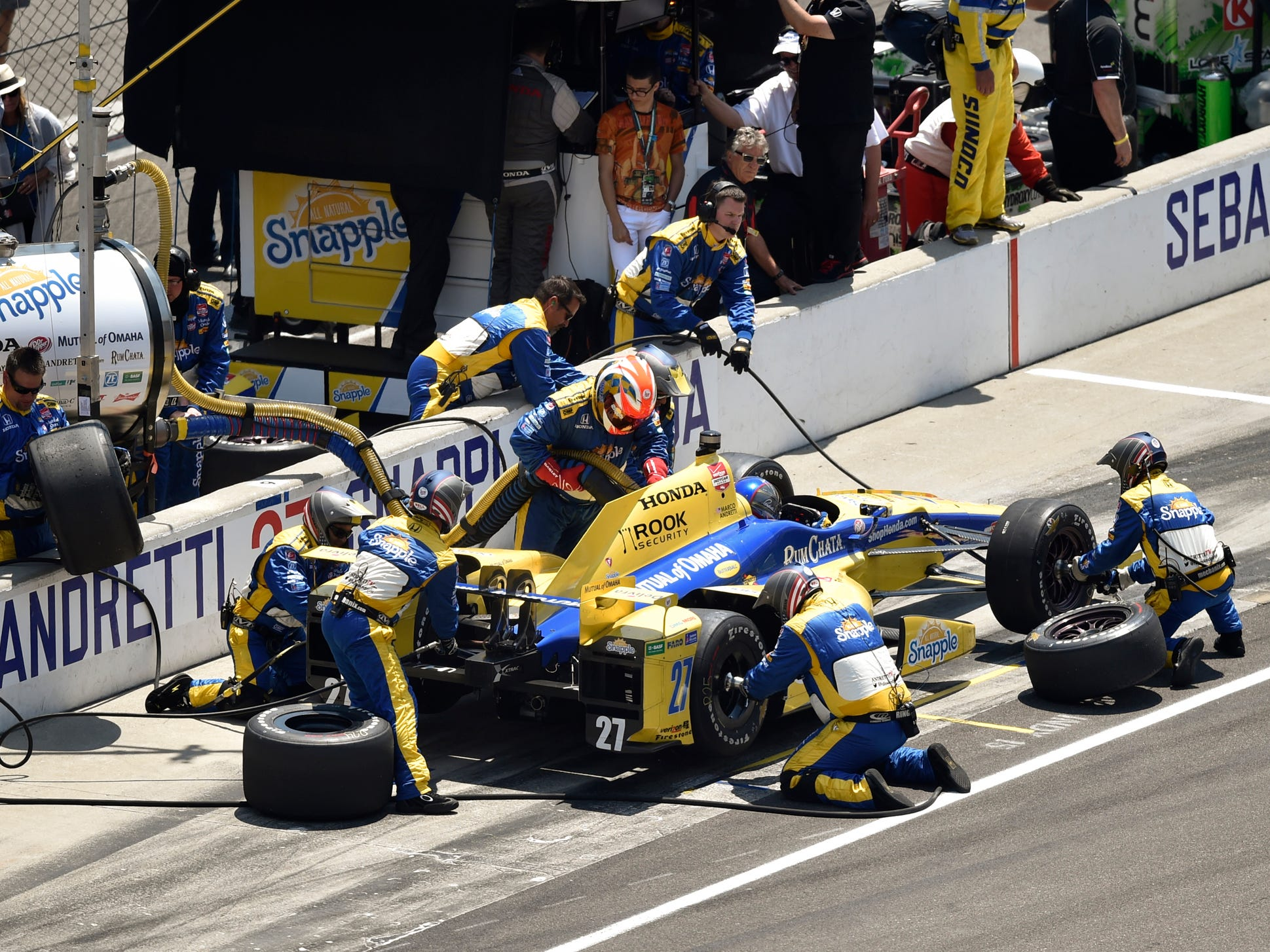 Marco Andretti makes a stop in his Honda on Sunday, May 24, 2015, at the 99th running of the Indianapolis 500 at the Indianapolis Motor Speedway. Jennifer Dummett / For the Star