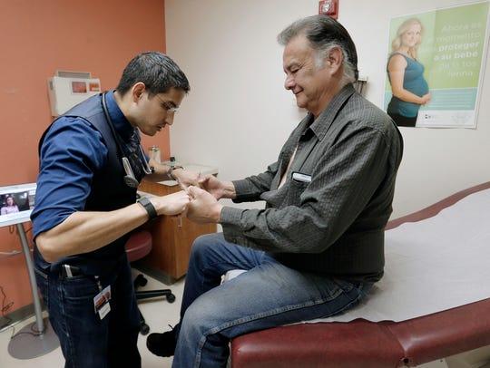 Centro San Vicente nurse practitioner Joshua Romero