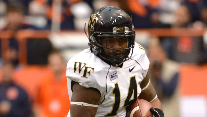 Wake Forest Demon Deacons running back Dominique Gibson (14) runs for yardage in the first quarter of a game at the Carrier Dome.