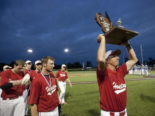 Homestead baseball coach Ernie Millard raises the WIAA