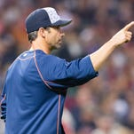 Tigers manager Brad Ausmus signals to the bullpen as he goes to the mound for a pitching change during the fifth inning of the Tigers' 5-3 loss to the Indians Monday in Cleveland.