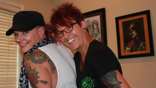 Lindsay Fulk, owner of Prismatic Ink Tattoo in Lebanon, and customer and cancer survivor Jen Shade of 105.7 The X radio station in York, pose after Fulk created a tattoo for Shade to kick off Fulk's sixth annual Cancer Ribbon Fundraiser. Cancer ribbon tattoos start at $30 with $10 from each being donated to the American Cancer Society. The fundraiser runs from Oct. 1-31. In the past five years, Fulk has raised just shy of $5,000 for the ACS. Shade got a teal ribbon representing cervical cancer on her left shoulder blade because the cancer is behind her. The shop is at 729 Walnut St. To make an appointment, call 717-450-4471.