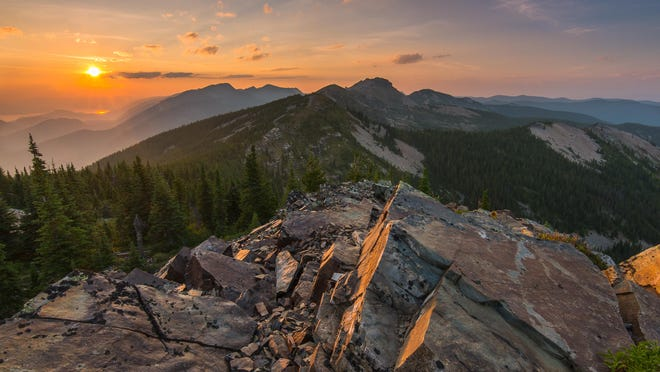 """""""Star Peak Sunset"""" features the sun setting behind the Cabinet Mountains. The photo, taken by Aaron Theisen of Spokane, was the grand winner of the Montana Wilderness Association's Picture Wild Montana photo contest."""