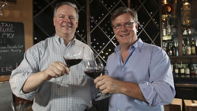 Scott Harper, left, managing partner of the several Bristol Bar and Grilles in the area, and Brett Davis, partner of the Falls City Hospitality Group, are master sommeliers. They were photographed at the Bristol in Jeffersonville on Aug. 18, 2015.