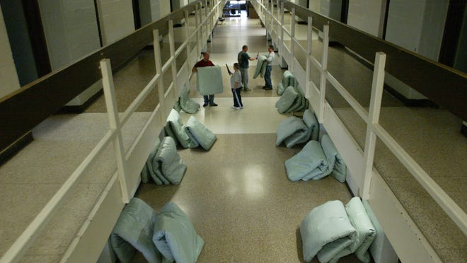 Corrections officers at the Muskegon Correctional Facility in Muskegon check mattresses for contraband.