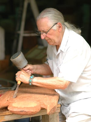 Olen Bryant works on a sculpture in his studio at New Deal in Cottontown in 2007.